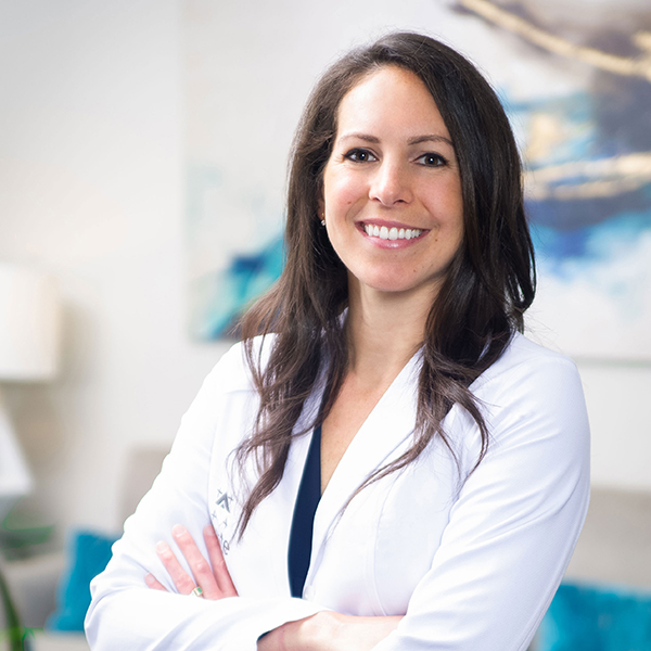 Dr. Megan Morrow poses with her arms crossed