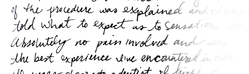 A white letter with black cursive text