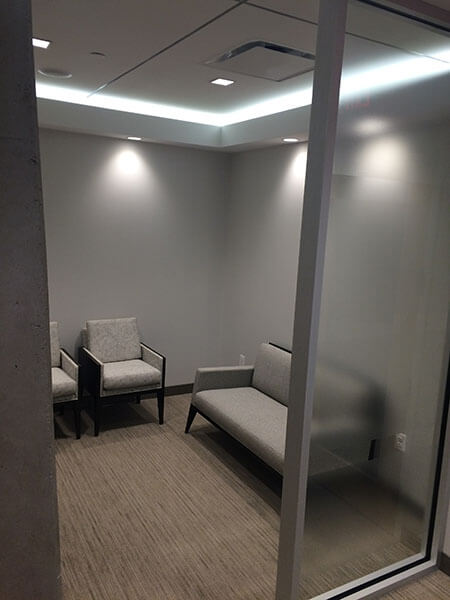 Our well lit, comfortable waiting area with neutral colored couches