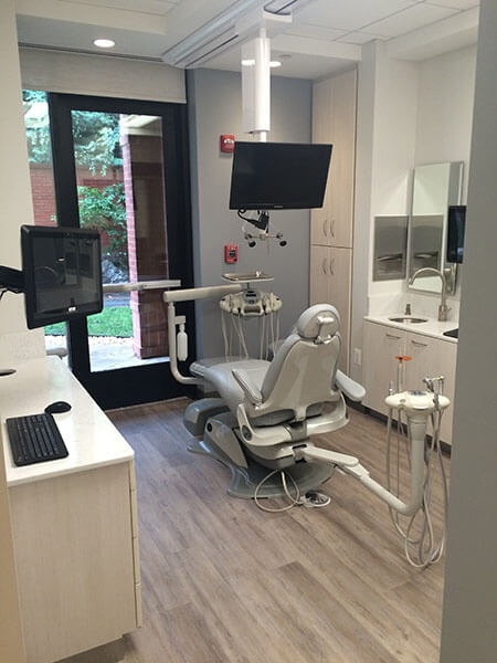 A dental chair with a television to watch during your procedure.