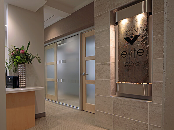 Our front desk and doors leading to our dental suites.