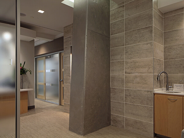 A grey pillar and granite walls.